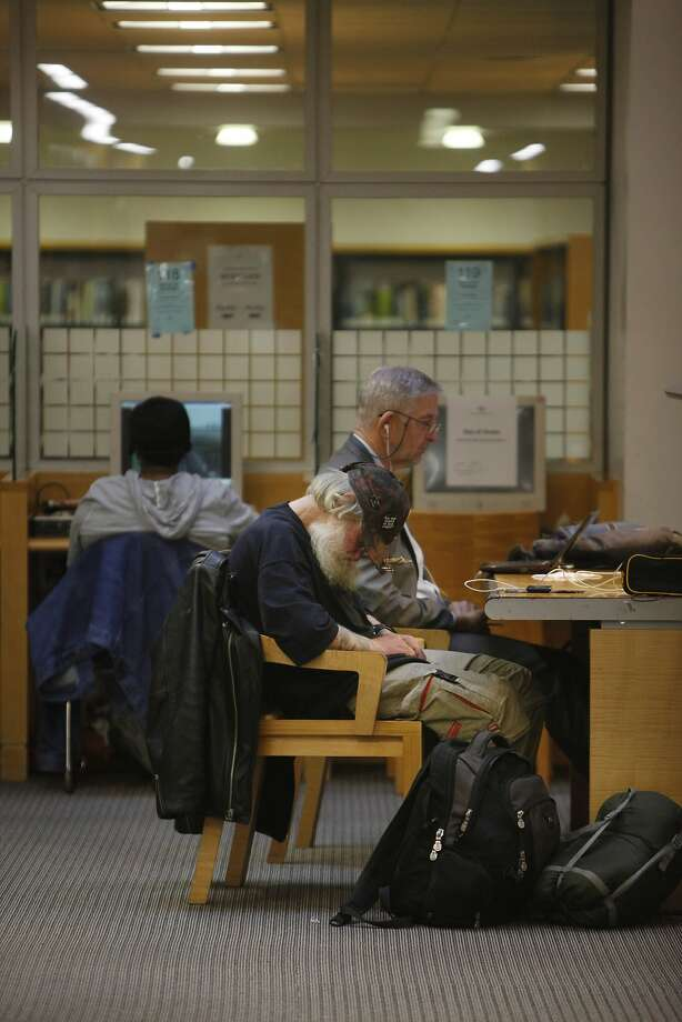 A man sleeps at the Main Library, where homeless people congregate. Photo: Lea Suzuki, The Chronicle