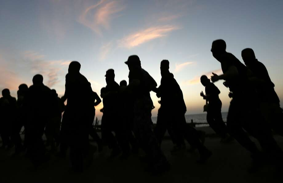Hooded Hamas militants exercise in Gaza City. Hamas is attempting to end a seven-year split with Fatah. Photo: Mohammed Abed, AFP/Getty Images