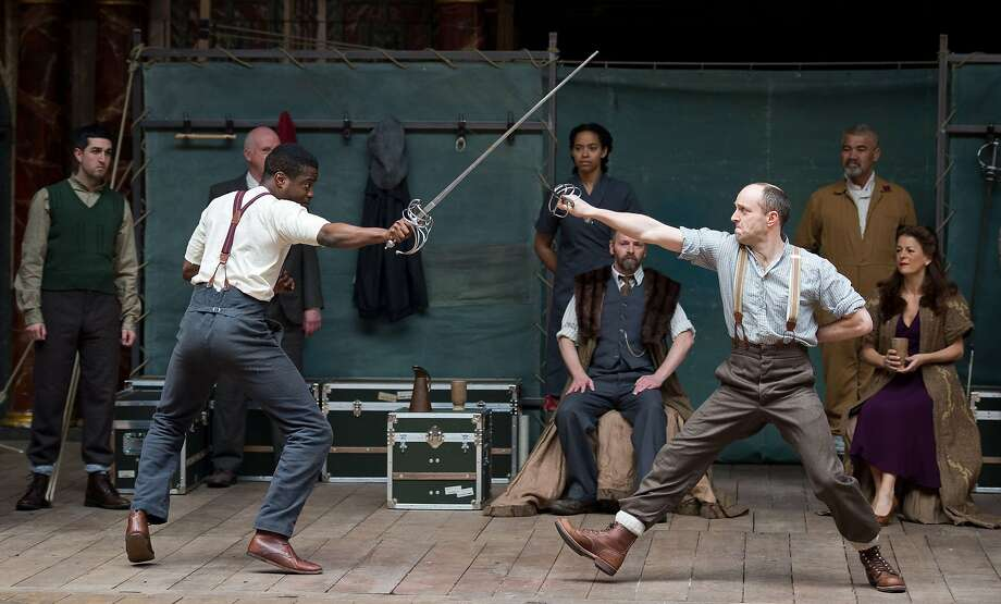 """Members of the cast of William Shakespeare's """"Hamlet"""" perform at the Globe theater in London. A world tour of the play is scheduled to last two years. Photo: Leon Neal, AFP/Getty Images"""