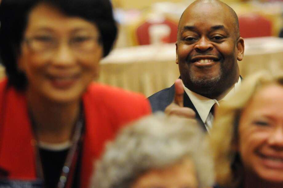 Niger Innis (rear right), a Republican congressional candidate, attends the annual Nevada Republican Party convention this month in Las Vegas. He wants to woo younger voters. Photo: Erik Verduzco, Associated Press