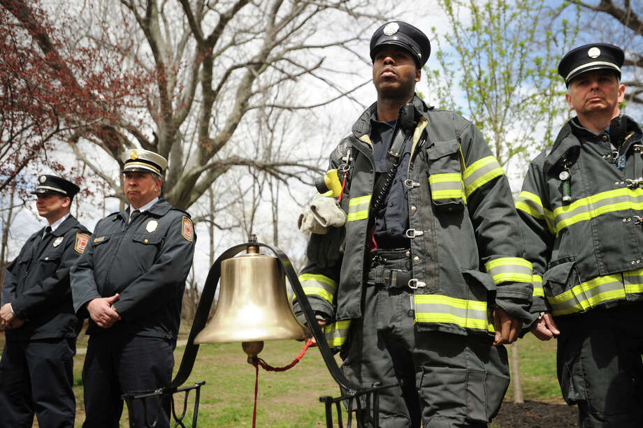 A bell is tolled for each of the 28 workers killed in the L'Ambiance Plaza collapse during the 27th anniversary ceremony outside City Hall in Bridgeport, Conn. on Wednesday, April 23, 2014. Photo: Brian A. Pounds / Connecticut Post