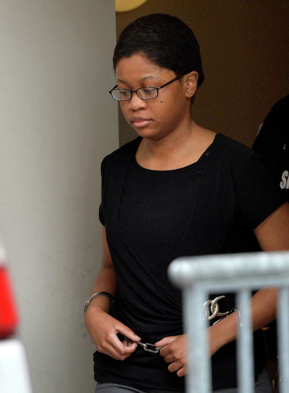 Trinity Copeland is lead from the rear of the Rensselaer County Courthouse in shackles and showing little emotion Wednesday afternoon April 23, 2014 in Troy, N.Y. after being convicted for the murder of her father. (Skip Dickstein / Times Union)