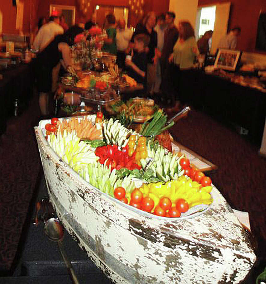 A bountiful boat of goodies presented by Garelick & Herbs, was one of the restaurant offeings at last year's Taste of Westport. Thisi year's event will be held May 1 at the Westport Inn. Photo: Staff Photo / Westport News
