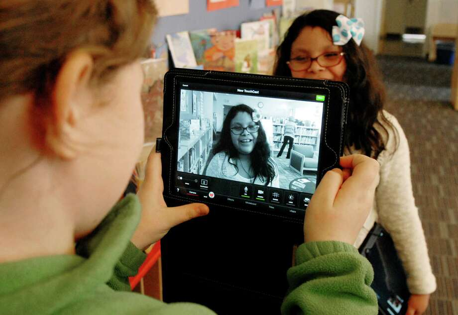 Kaycee Piro films Camila Guadalupe with a iPad at Hamilton Avenue School on Monday March 31, 2014 as part of Greenwich school district's Digital Learning Environment initiative. Photo: Dru Nadler / Stamford Advocate Freelance