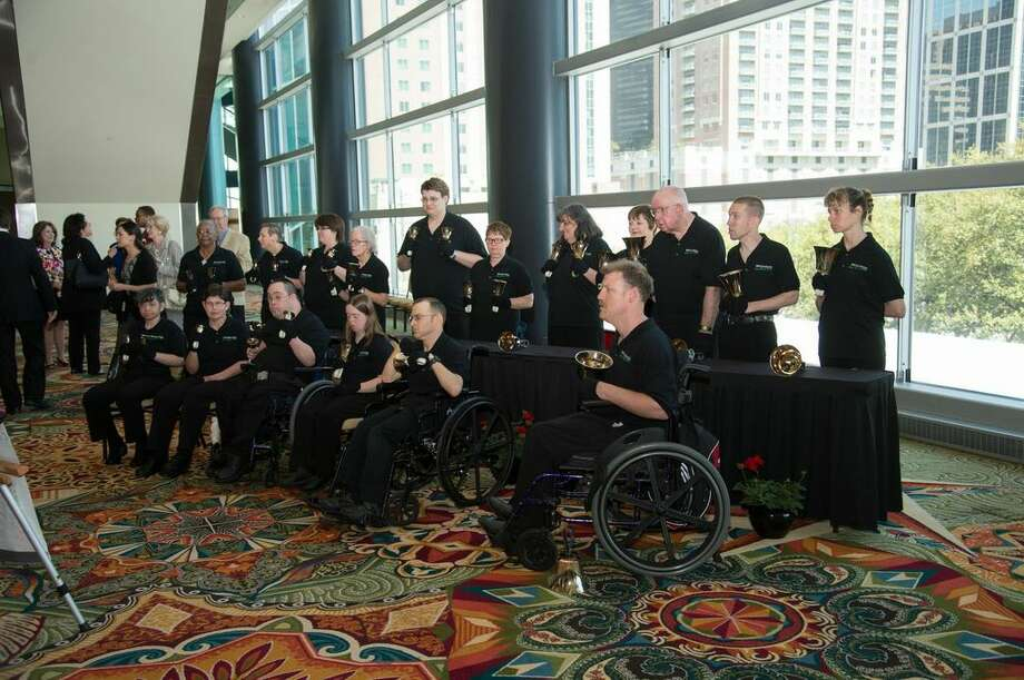 The Brookwood Handbell Choir performs as the guests arrived April 4, 2014 at the benefit luncheon. Photo: Temple Webber