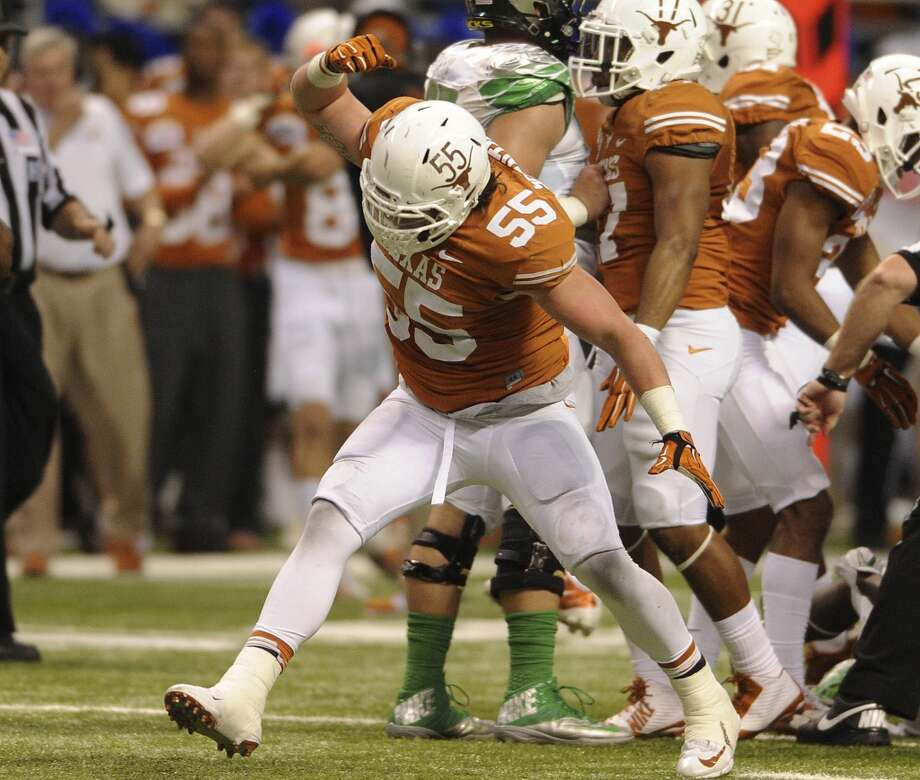 Dalton Santos of the Texas Longhorns reacts after stopping an Oregon runner during first-half action of the Valero Alamo Bowl in the Alamdome on Monday, Dec. 30, 2013. Photo: Billy Calzada, San Antonio Express-News