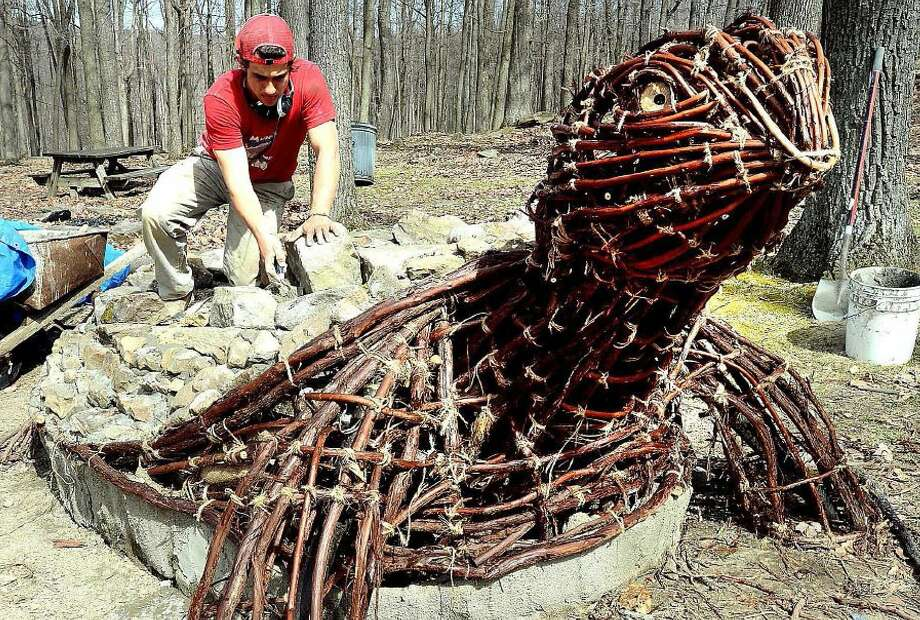 The truth about Ben Gazsi:Ben Gazsi is a West Virginia University senior art student who's building a giant turtle in honor of Earth Day. He's using twisted grape vines, concrete and stone for the piece at Coopers Rock State Park in Bruceton Mills. Photo: Ron Rittenhouse, Associated Press
