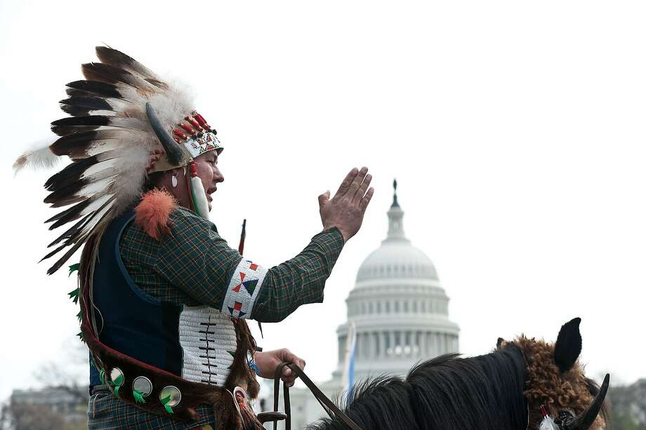 Pipeline protest:A mounted Native American in full headdress denounces the proposed Keystone XL pipeline outside the 