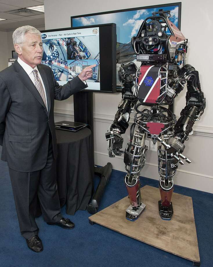 Army's soldier of the future: Secretary of Defense Chuck Hagel is briefed on the ATLAS robot, one of the most 