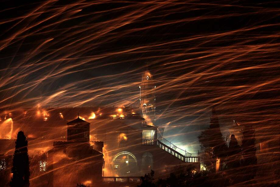 Pyrotechnic rockets stream over the bell towel of Panagia Erithiani Church during Greek Orthodox Easter celebrations on the eastern Aegean island of Chios. The tradition is at least 125 years old. Photo: Petros Giannakouris, Associated Press