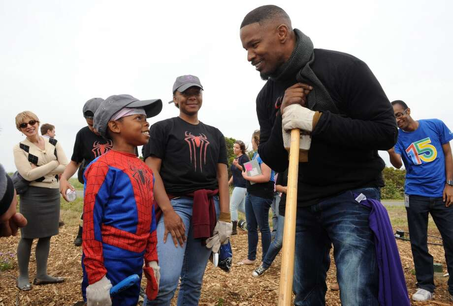 Jamie Foxx and a Spider-Man at a Be Amazing habitat restoration project on Monday April 21 at Shoreline Park in Mountain View. Photo: Susana Bates