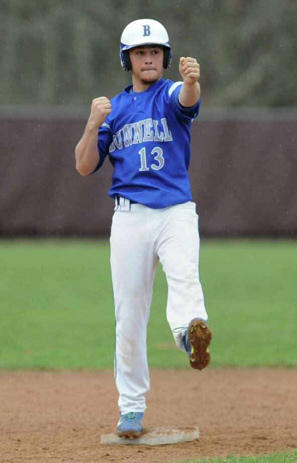 Bunnell's Jeremy Proto celebrates after getting a hit in Bunnell's win over Pomperaug in the high school baseball game at Pomperaug High School in Southbury, Conn. Tuesday, April 22, 2014. Photo: Tyler Sizemore / The News-Times