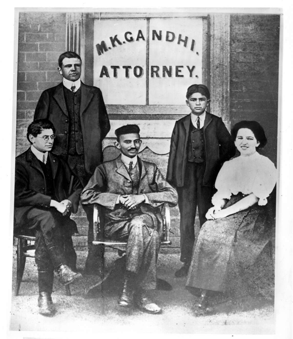 Mohandas K. Gandhi, center seated, was surrounded by workers in his law office in Johannesburg, South Africa, in a picture made about 1902. Gandhi spent most of his 20 years there protesting treatment of his fellow Indian countrymen by British colonists.