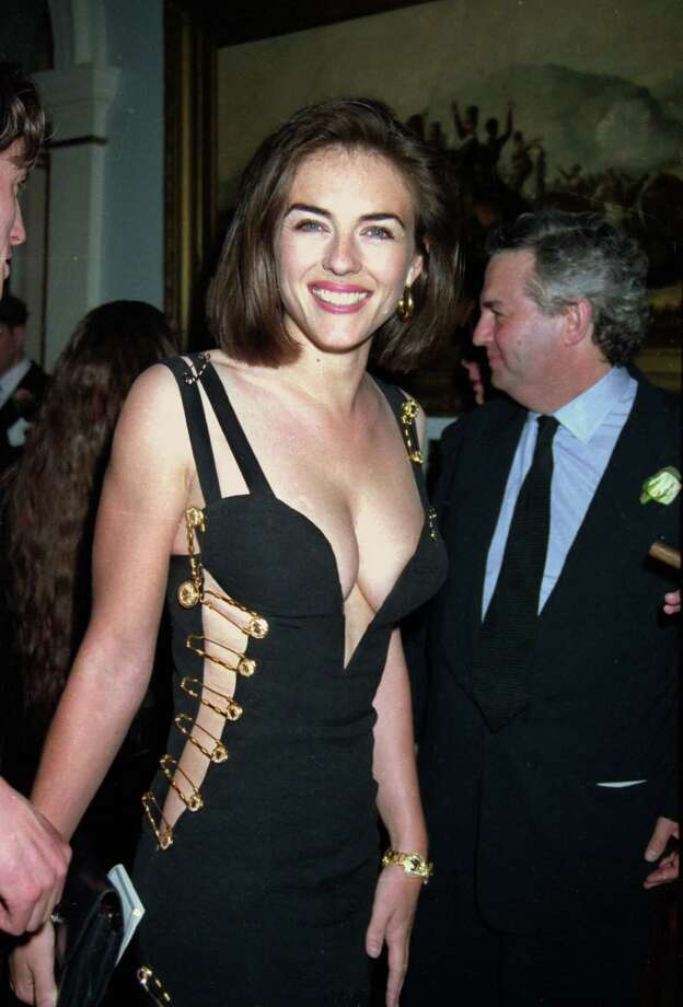 Before she was known as an actress, Elizabeth Hurley was a model and known mostly as Hugh Grant's girlfriend. She made a big splash in 1994 in this safety-pin dress.  Photo: Dave Benett, Getty Images / 2004 Getty Images
