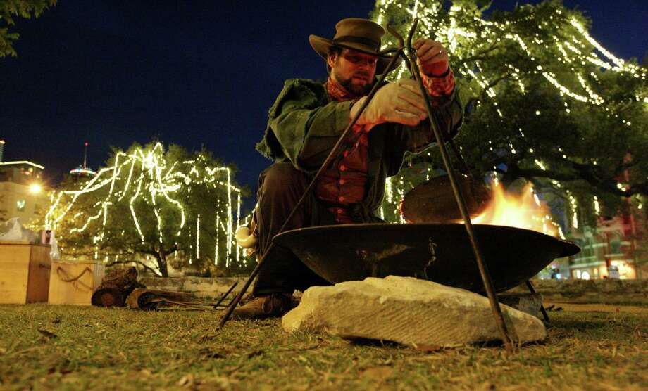 Grant Maloney of the San Antonio Living History Association  sets up camp in Alamo Plaza last December.   A reader says it is time for school textbooks to include the other side of Texas history — the Latino side. Photo: Edward A. Ornelas / San Antonio Express-News / © 2013 San Antonio Express-News