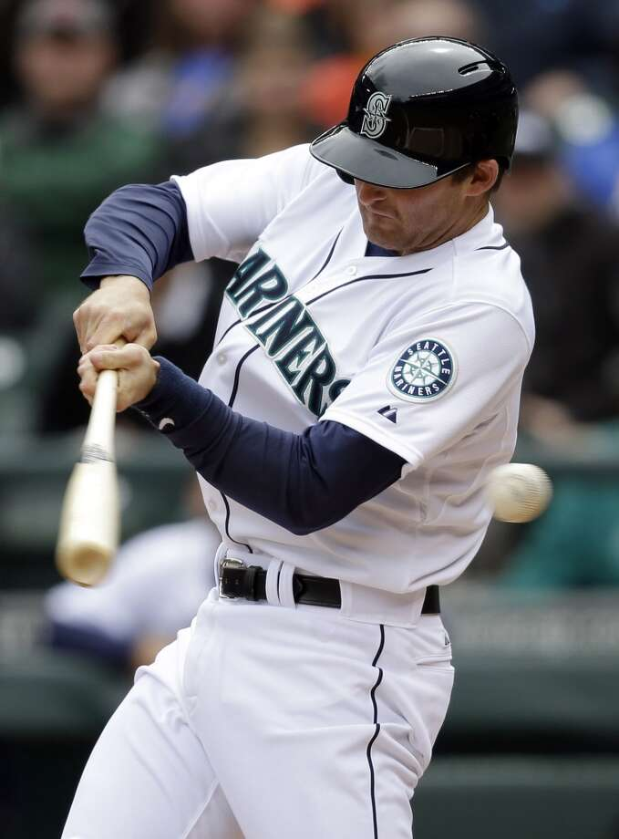 Brad Miller swings at and misses a pitch in the first inning. Photo: Elaine Thompson, Associated Press