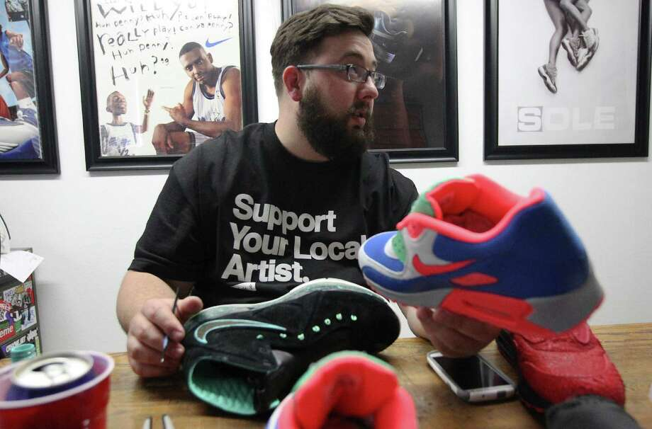 "Local sneaker customizer Jake Danklefs has made one-of-a-kind shoes for rappers, Olympians and the King, LeBron James. For a cost of $300 to $1,000, Danklefs gives sneakers a new paint job, can add logos or decals and make over everything including the insoles, giving soul to your soles. It's part of a growing ""sneakerhead"" culture where the shoes are wearable art. Here's a slideshow of some of Danklefs' works.Read the full story on ExpressNews.com. Photo: Kin Man Hui, San Antonio Express-News / ©2014 San Antonio Express-News"