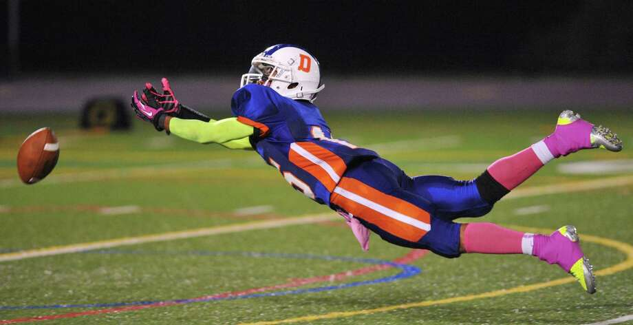 Danbury receiver Tysheen McCrea dives for a ball in the FCIAC high school football game between Danbury and Bridgeport Central at Danbury High School in Danbury, Conn. on Friday, Oct. 4, 2013. Photo: Tyler Sizemore / The News-Times