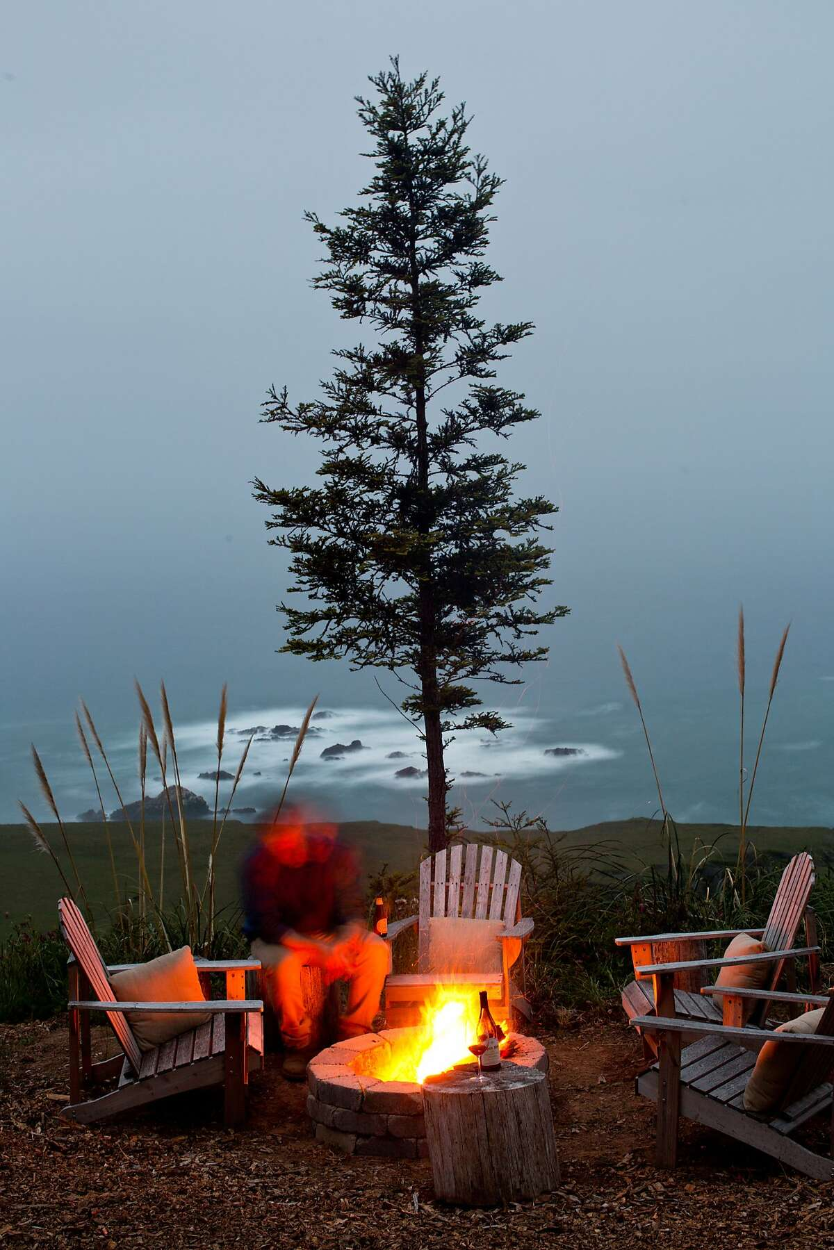 """Stewart's Point store has set up a number of """"glamping"""" tents overlooking the ocean with luxurious bedding and wood fireplace for heat on the coast of Sonoma County, Calif., Monday, April 21, 2014. Here a fire pit overlooks the coastline to Stewarts Point."""