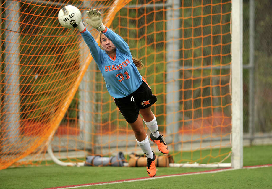 Stamford goalie Alexandra Lemekha makes a diving save on a free kick during their game against Westhill at Stamford High School on Thursday, Oct. 10, 2013. Westhill won, 4-0. Photo: Jason Rearick / Stamford Advocate