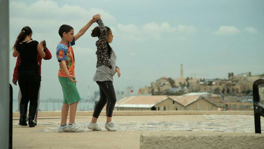 "Arab and Israeli children step out together in Hilla Medalia's documentary ""Dancing in Jaffa,"" which looks at a ballroom dancer's educational program. Photo: IFC Films"