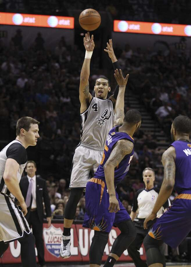 Spurs' Danny Green (04) hoists up a three-pointer to finish off the first quarter against the Phoenix Suns in the first half at the AT&T Center on Friday, Apr. 11, 2014. Photo: Kin Man Hui, San Antonio Express-News