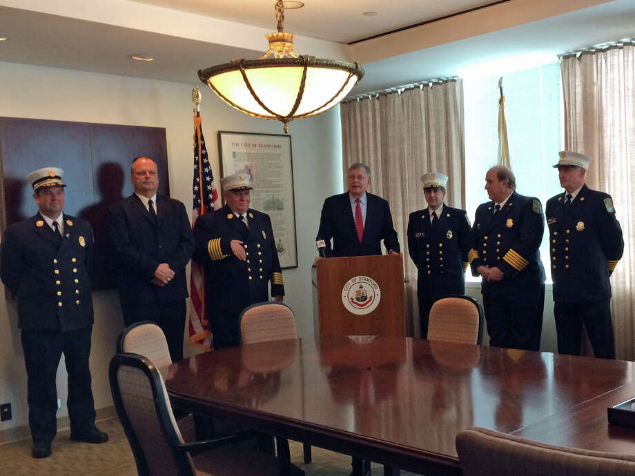 Mayor David Martin announces an agreement with members of the Turn of River Fire Department ending a lawsuit between the city and the volunteer department following a Charter referendum to consolidate the department under one chief. Photo: Kate King / Stamford Advocate
