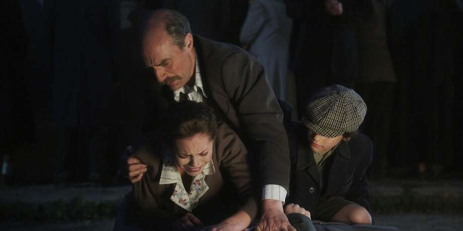 "Simon Kunz, Hannah Tointon (below him) and Marian Soare Aurelain star in ""Walking With the Enemy,"" a story inspired by true events about the effort to save Jews in Hungary from the Nazis during World War II. Photo: Liberty Studios"