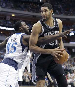 April 10, 2014: Spurs 109, Mavericks 100 San Antonio Spurs forward Tim Duncan (21) is fouled by Dallas Mavericks center DeJuan Blair (45) during the first half an NBA basketball game Thursday, April 10, 2014, in Dallas. Photo: LM Otero, Associated Press