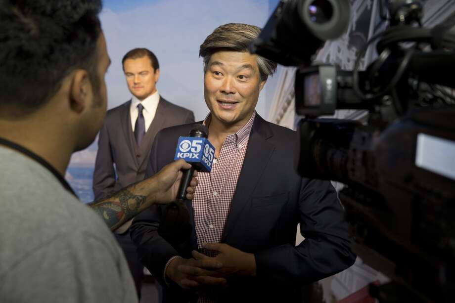 Rodney Fong, Vice President of the San Francisco Planning Commission, is interviewed in front of a wax figure of Leonardo DiCaprio on display at the future site of Madame Tussaud's attraction in San Francisco's Fisherman's Warf on Wednesday April 23, 2014. Photo: Beck Diefenbach, Beck Diefenbach/Madame Tussauds