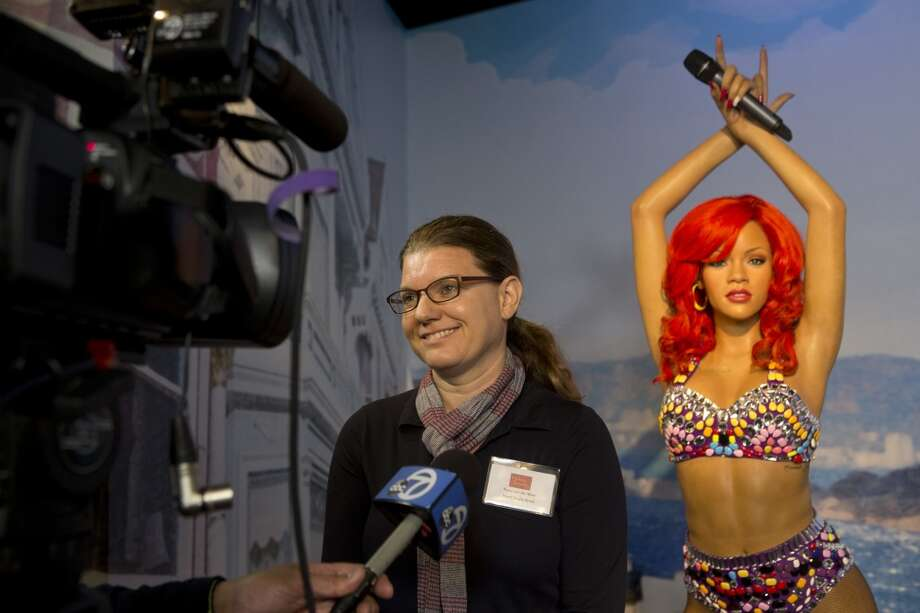 Head studio artist Petra van der Meer is interviewed in front of a wax figure of Rihanna on display at the future site of Madame Tussaud's attraction in San Francisco's Fisherman's Warf on Wednesday April 23, 2014. Photo: Beck Diefenbach, Beck Diefenbach/Madame Tussauds