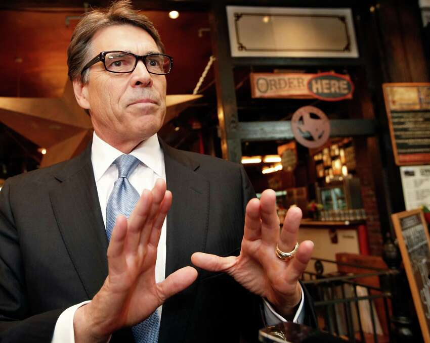 Texas Gov. Rick Perry speaks to reporters after meeting with business owners Wednesday, April 23, 2014, in New York. Perry, a Republican, made the trip to try to convince companies to move their operations to Texas, where he says the business climate is friendlier. (AP Photo/Kathy Willens)