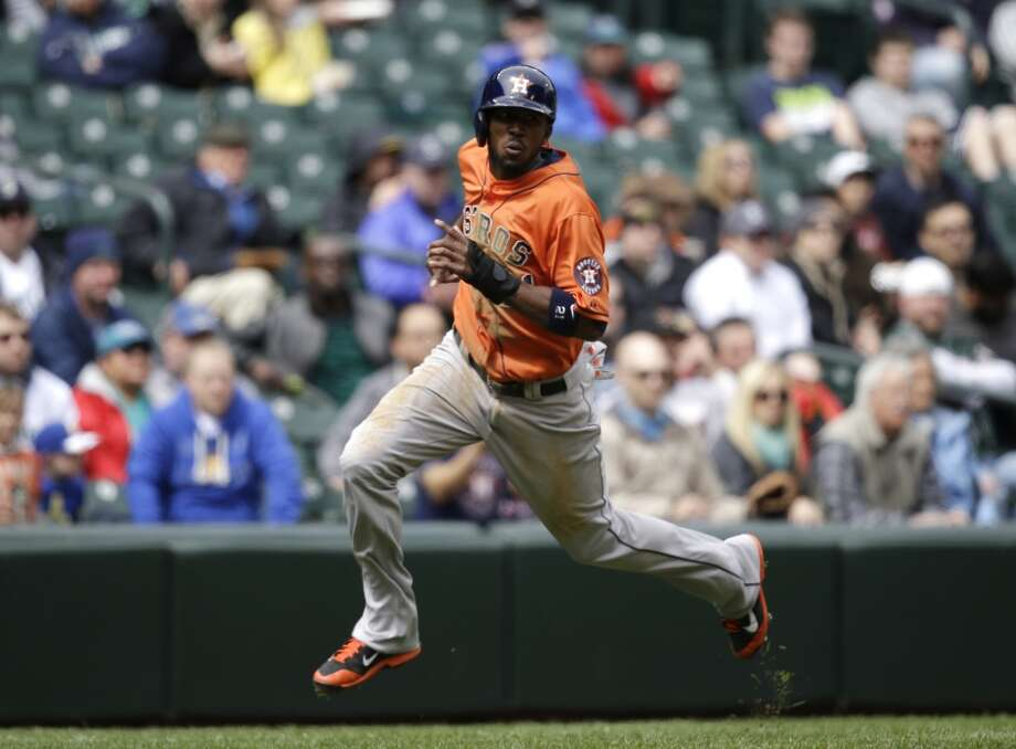 Dexter Fowler heads home in the third inning. Photo: Elaine Thompson, Associated Press