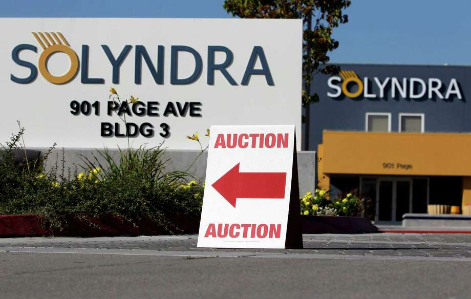 An auction sign at the bankrupt Solyndra headquarters in Fremont in 2011. Photo: Paul Sakuma / Paul Sakuma / ASSOCIATED PRESS / ONLINE_YES