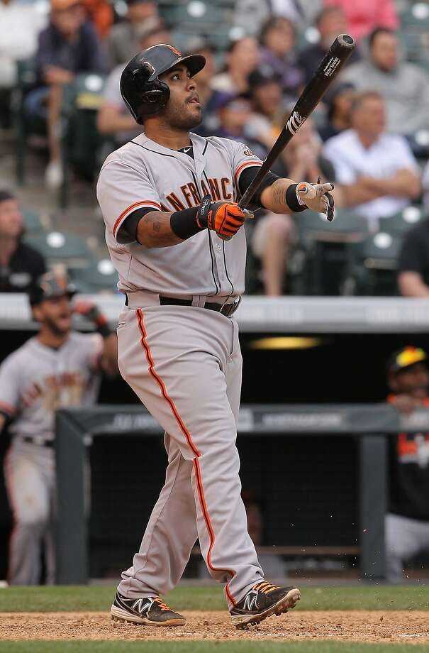 Giants backup catcher Hector Sanchez watches his grand slam in the 11th inning, his second home run of the game. Photo: Doug Pensinger, Getty Images