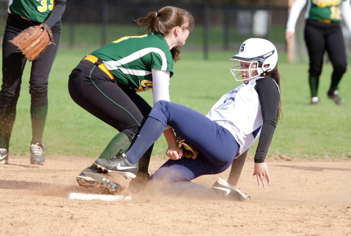 Trinity Catholic's Leah Zarrilli (3) tags Staples' Gabriella Perry (12) on second base during the softball game at Wakeman Field in Westport on Wednesday, Apr. 23, 2014.