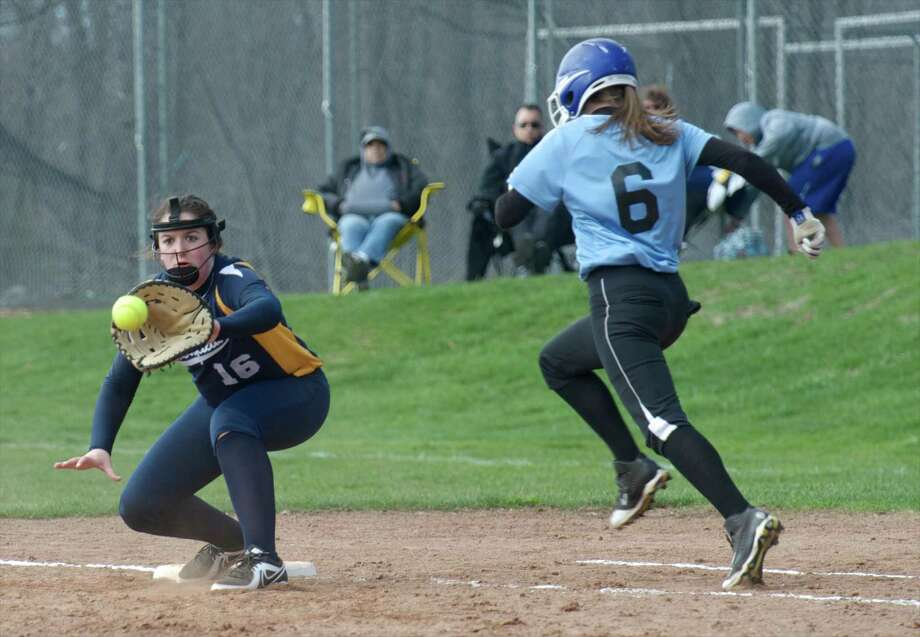 Brookfield's Kimberly Reilly, #16, waits for the throw to put out Oxford's Natalie Peterson, #6, at first base during the girls softball game between Oxford High School and Brookfield High School, in Brookfield, Conn, on Wednesday, April 23, 2014. Photo: H John Voorhees III / The News-Times Freelance