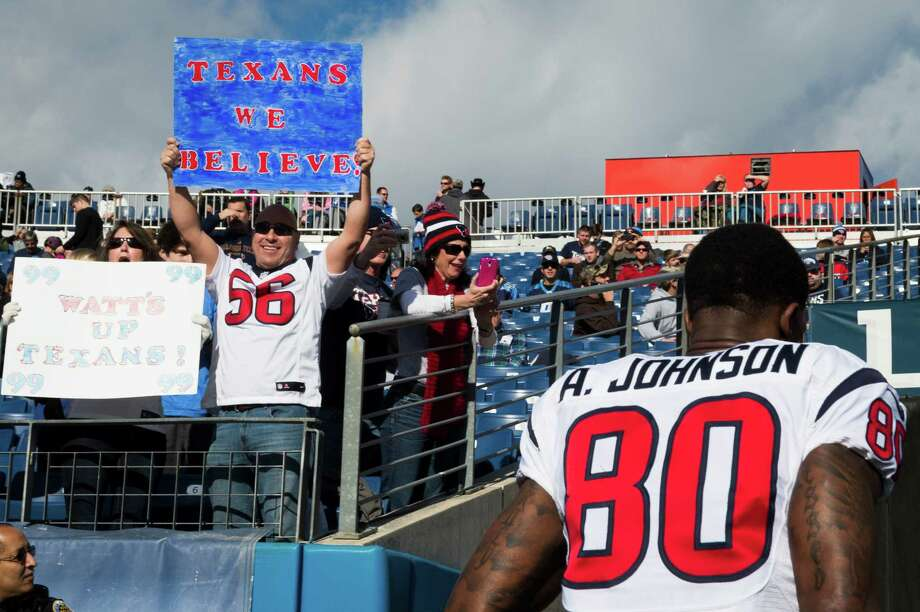 Houston Texans fans cheer wide receiver Andre Johnson as he leaves the field after warm ups before an NFL football game last season in Nashville. The Texans will open the 2014 regular season at home against the Washington Redskins. ( Smiley N. Pool / Houston Chronicle ) Photo: Smiley N. Pool, Staff / © 2013  Houston Chronicle