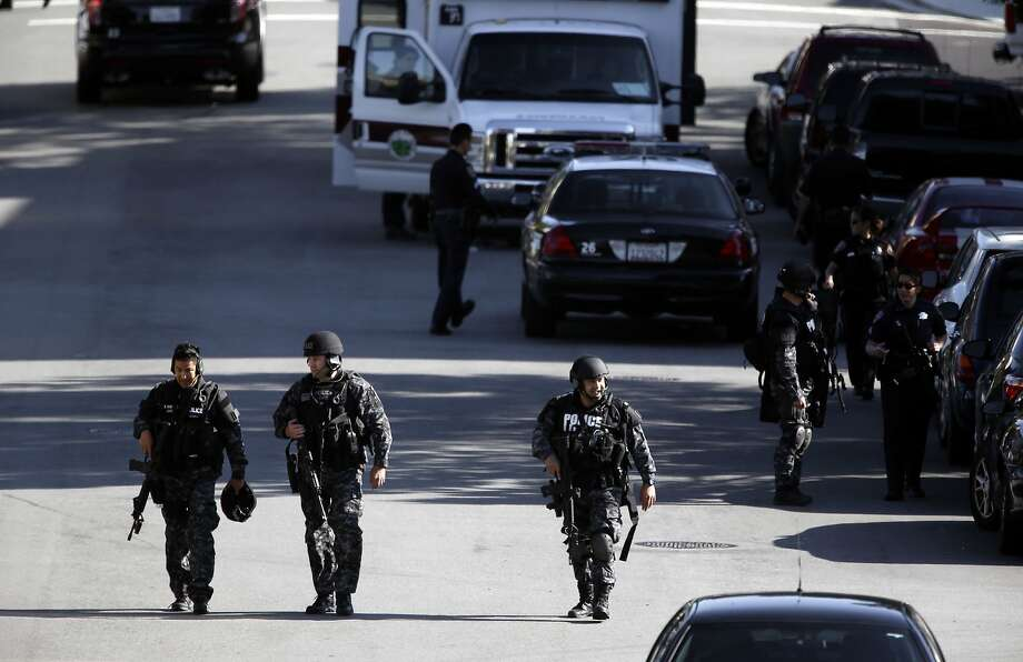 A tactical group wraps up their search after police responded to reports of a man with a gun inside a Seton Medical center building near the hospital, in Daly City, Calif.,  which turned out to be unfounded  on Wednesday April 23, 2014. Photo: Michael Macor, The Chronicle