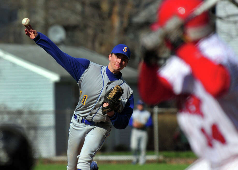 Seymour pitcher Jake Walkinshaw sends the ball to Derby's Michael Koval, during baseball action against Seymour at French Memorial Park in Seymour, Conn. on Wednesday April 23, 2014. Photo: Christian Abraham / Connecticut Post