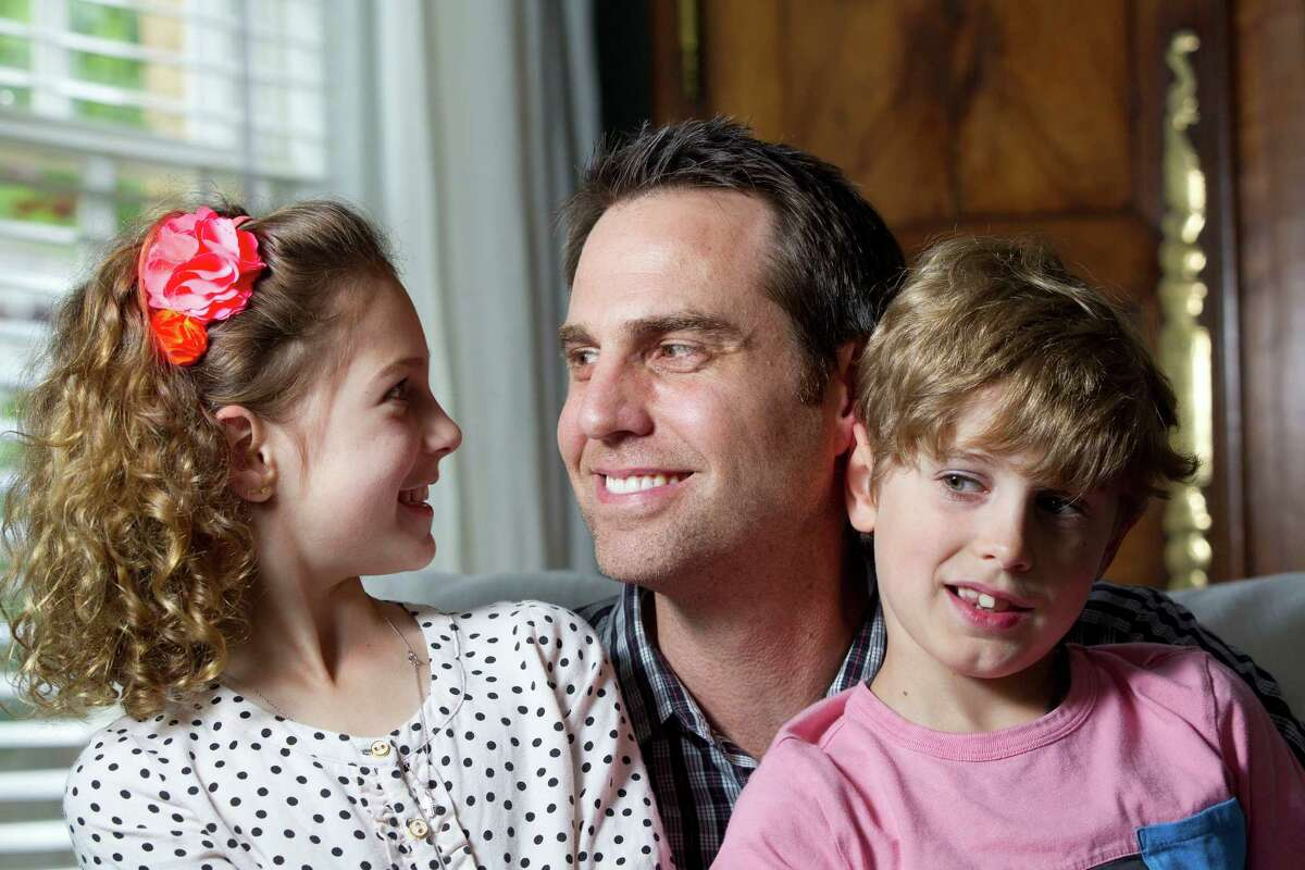 Gordon Doran, 39, and his two children, Olivia, 9, and Reeve, 7, of Houston have struggled with dyslexia. The Barbara Bush Houston Literacy Foundation aims to help people achieve literacy goals.