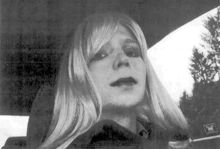 U.S. Army, Pfc. Chelsea Manning poses for a photo wearing a wig and lipstick. Photo: Associated Press / U.S. Army