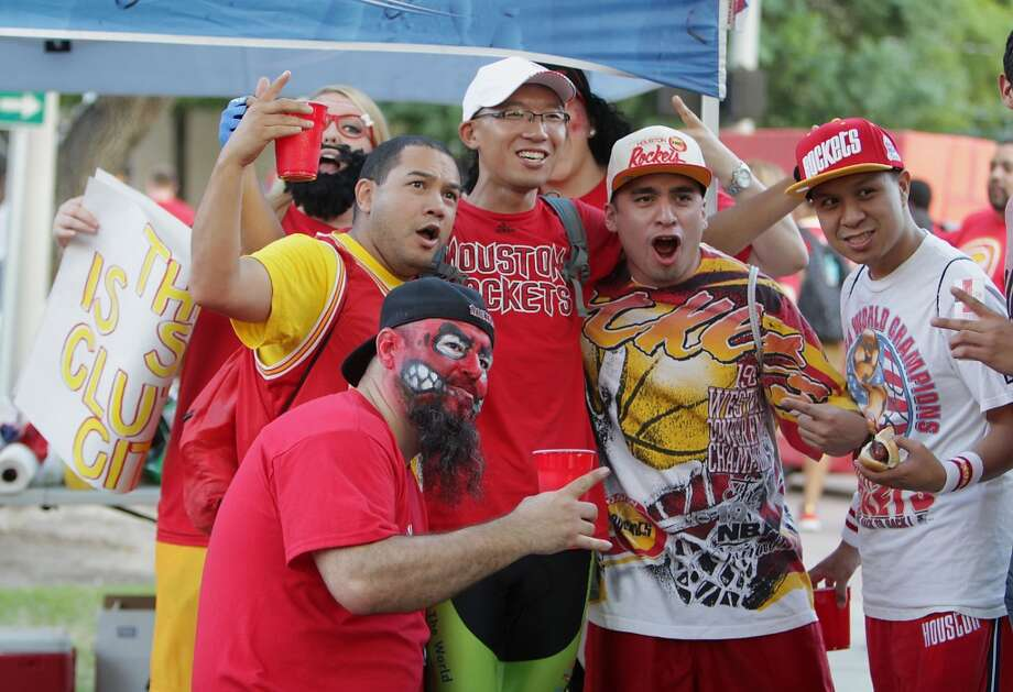 Fans take part in the pre-game festivities outside Toyota Center for game 2 of the Western Conference playoffs. Photo: James Nielsen, Houston Chronicle