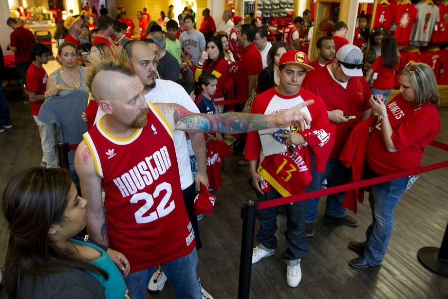 Houston Rockets fan B.J. Butler (22) waits in line to check out in the Rockets gift shop before Game 2 of the NBA Western Conference Quarterfinals against the Portland Trail Blazers at Toyota Center Wednesday, April 23, 2014, in Houston. ( Brett Coomer / Houston Chronicle ) Photo: Brett Coomer, Houston Chronicle