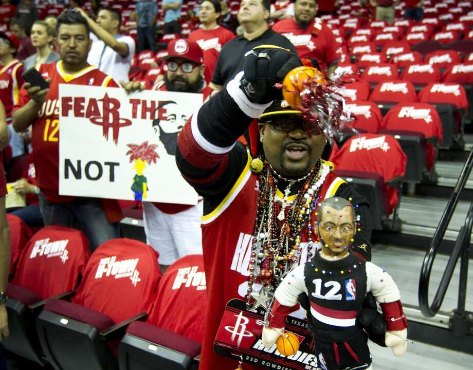 "Houston Rockets fan Paul ""Mr. Mardi Gras"" Dalcoe shakes a voodoo doll resembling Portland Trail Blazers forward LaMarcus Aldridge before Game 2 of the NBA Western Conference Quarterfinals at Toyota Center Wednesday, April 23, 2014, in Houston. ( Brett Coomer / Houston Chronicle ) Photo: Brett Coomer, Houston Chronicle"