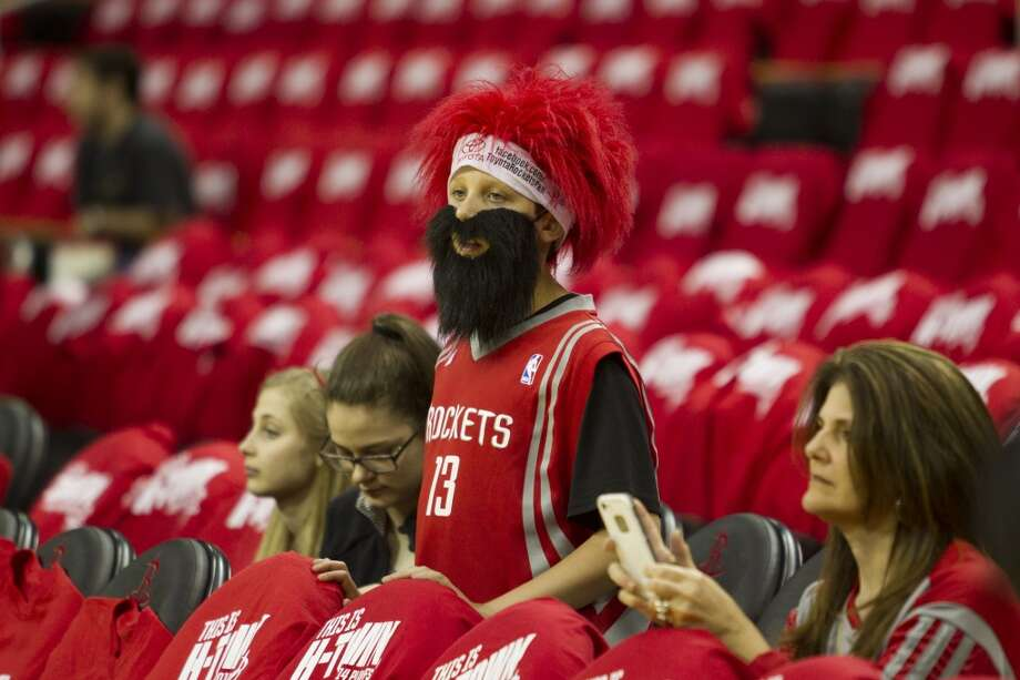 Houston Rockets fans watch warm-ups before Game 1 of the NBA Western Conference Quarterfinal basketball playoff game against the Portland Trail Blazers at Toyota Center Sunday, April 20, 2014, in Houston. ( Brett Coomer / Houston Chronicle ) Photo: Brett Coomer, Houston Chronicle