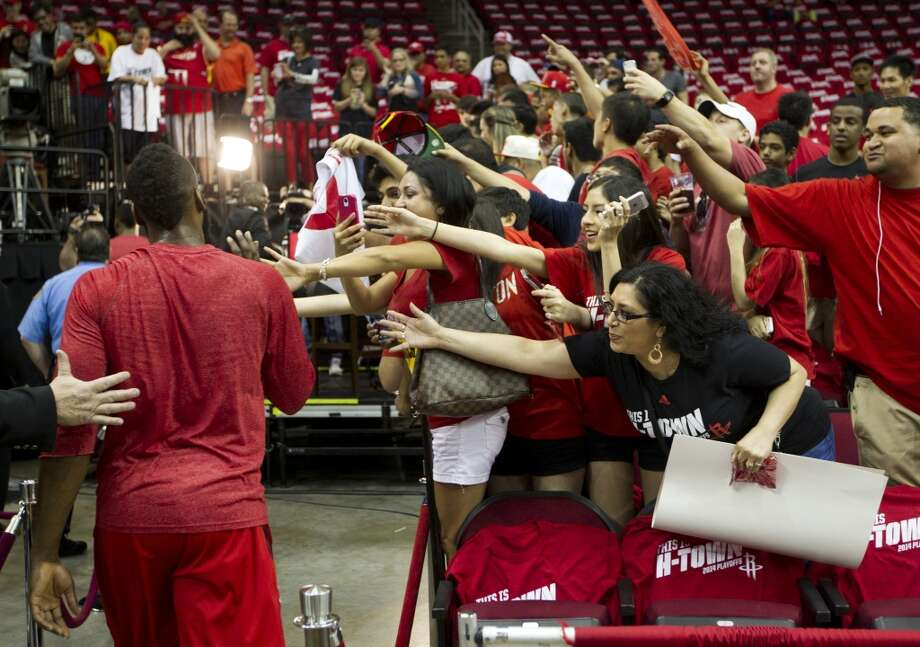 Houston Rockets fans reach out for high-fives from guard James Harden before Game 1 of the NBA Western Conference Quarterfinal basketball playoff game against the Portland Trail Blazers at Toyota Center Sunday, April 20, 2014, in Houston. ( Brett Coomer / Houston Chronicle ) Photo: Brett Coomer, Houston Chronicle
