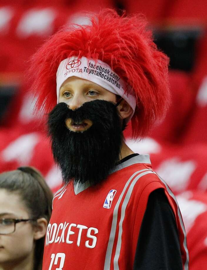 HOUSTON, TX - APRIL 20:  A young Houston Rockets fan wears his James Harden beard as he looks on before Game One of the Western Conference Quarterfinals during the 2014 NBA Playoffs at the Toyota Center on April 20, 2014 in Houston, Texas. NOTE TO USER: User expressly acknowledges and agrees that, by downloading and or using this photograph, User is consenting to the terms and conditions of the Getty Images License Agreement.  (Photo by Bob Levey/Getty Images) Photo: Bob Levey, Getty Images