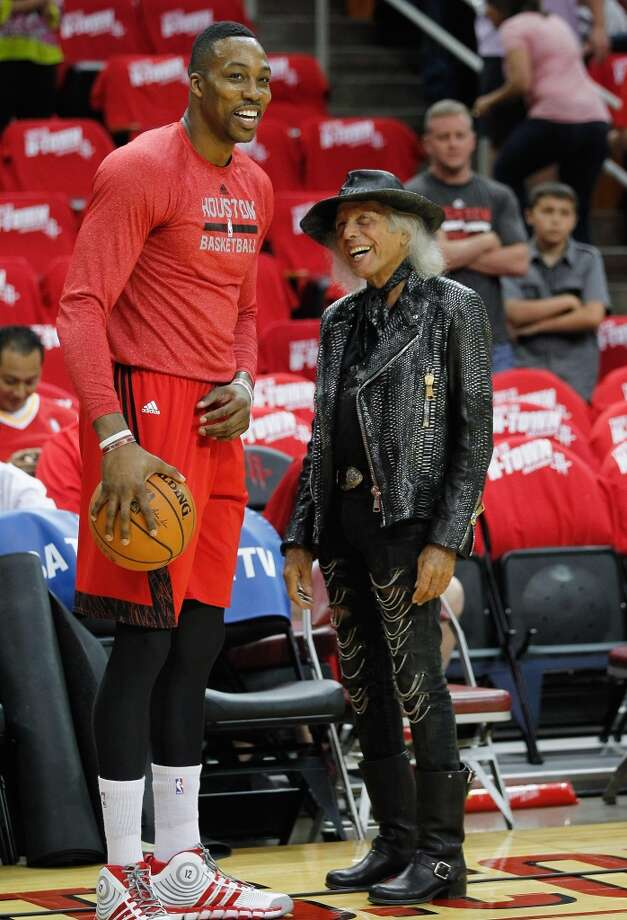 HOUSTON, TX - APRIL 20:  Dwight Howard #12 of the Houston Rockets talks with NBA fan Jimmy Goldstein before Game One of the Western Conference Quarterfinals during the 2014 NBA Playoffs at the Toyota Center on April 20, 2014 in Houston, Texas. NOTE TO USER: User expressly acknowledges and agrees that, by downloading and or using this photograph, User is consenting to the terms and conditions of the Getty Images License Agreement.  (Photo by Bob Levey/Getty Images) Photo: Bob Levey, Getty Images