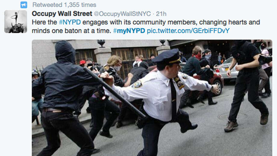 This Twitter post showing a New York police officer attacking a protestor is one of many unfavorable tweets the NYPD received. Photo: Associated Press / AP